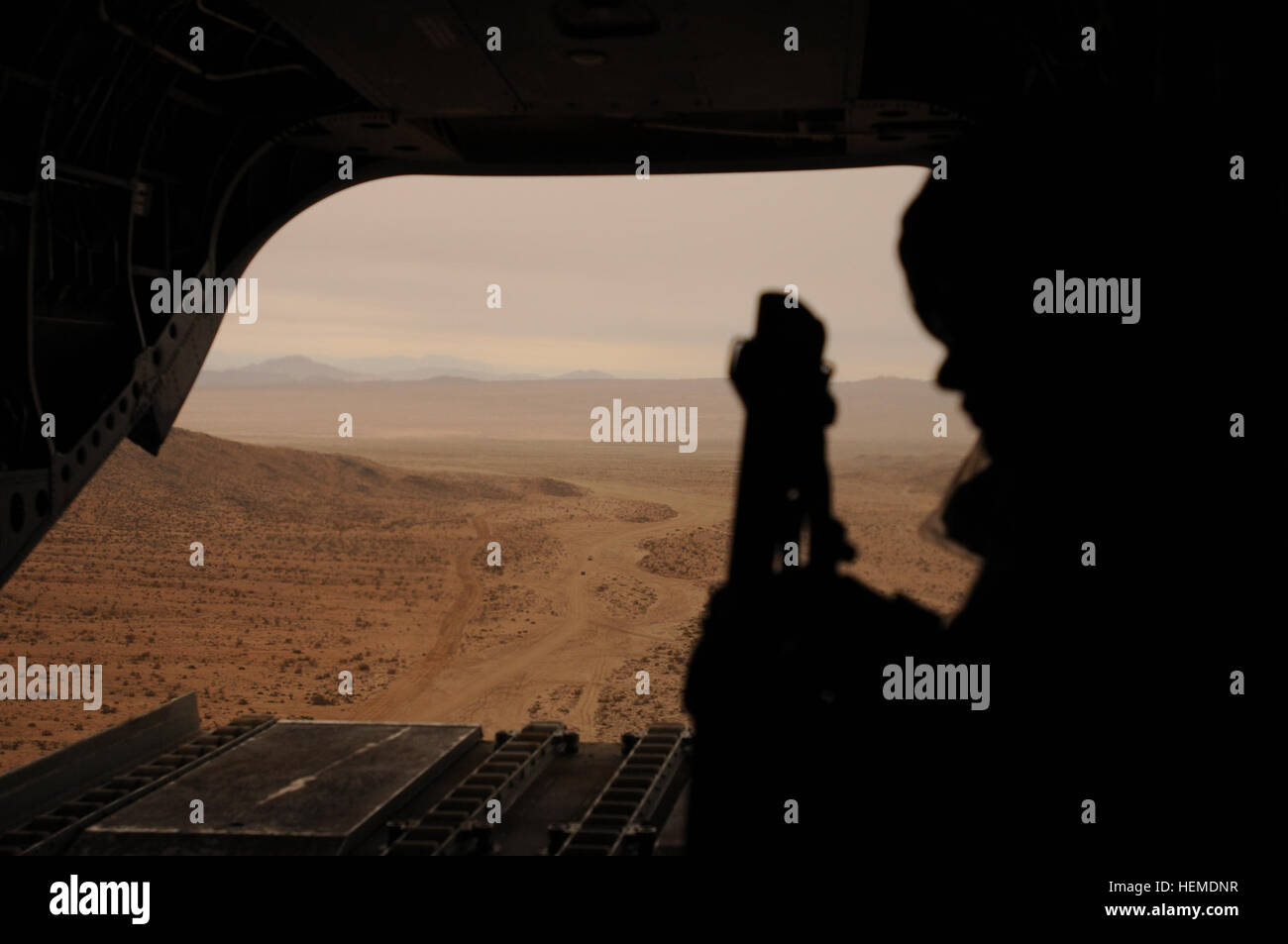 A Chinook crew takes in the view from above during 3rd Brigade Combat Team, 1st Cavalry Division's rotation - Stock Image