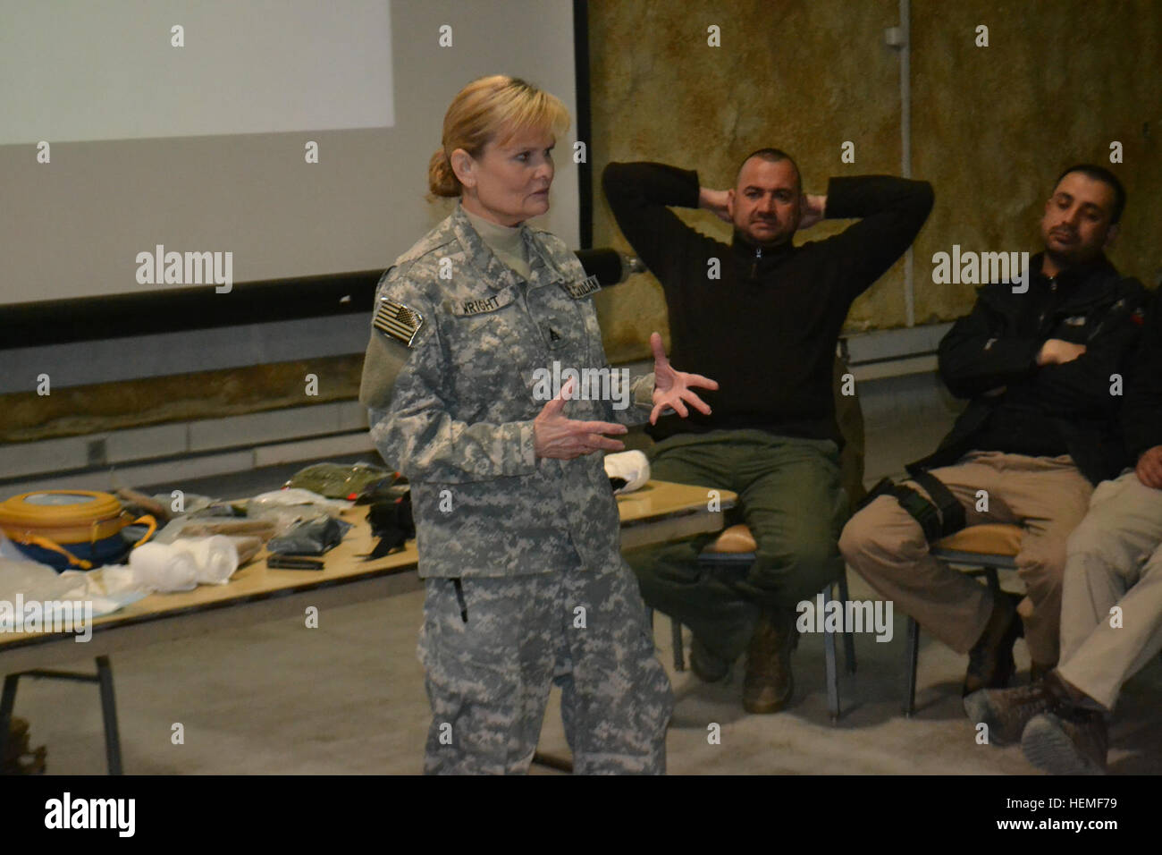 USACE Transatlantic District North's occupational health nurse, Judi Wright, RN, instructs Burhan Security Services - Stock Image