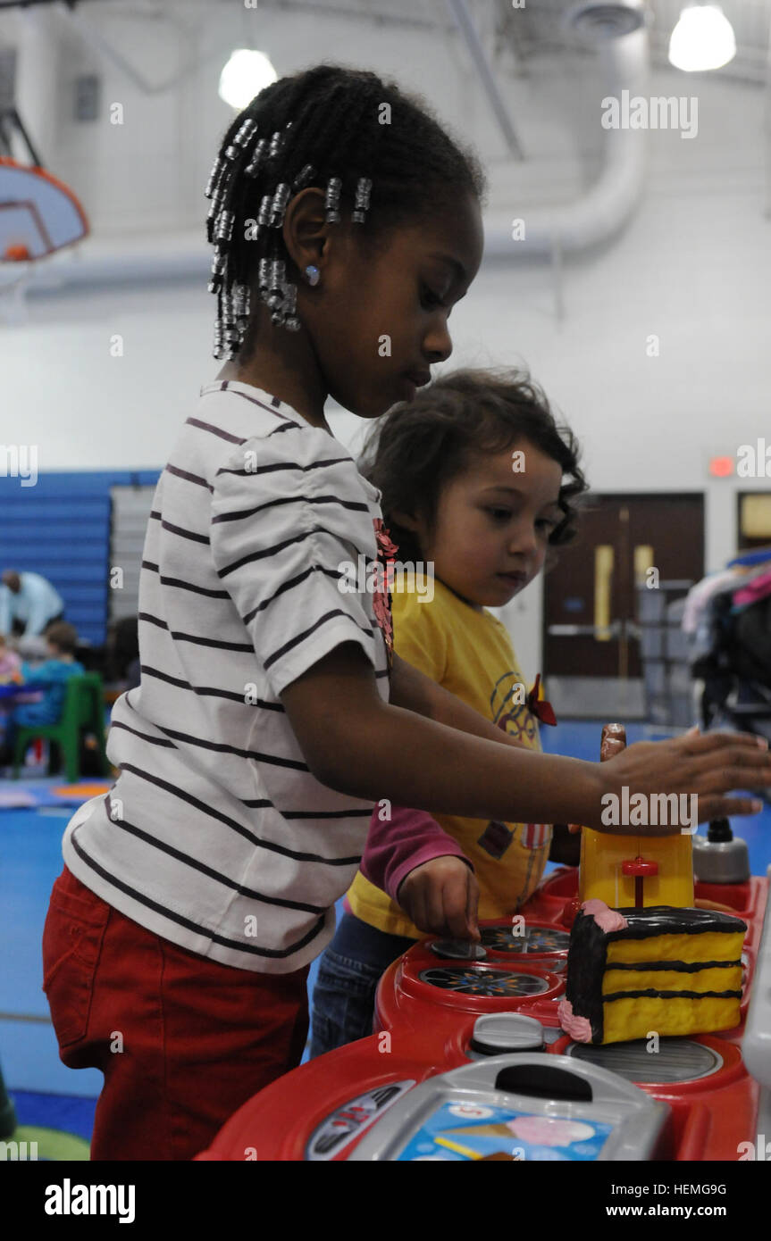 Chloe Hopes (left) interacts with Lana Hammonds (right) during an open playgroup at the Bronco Youth Center April - Stock Image