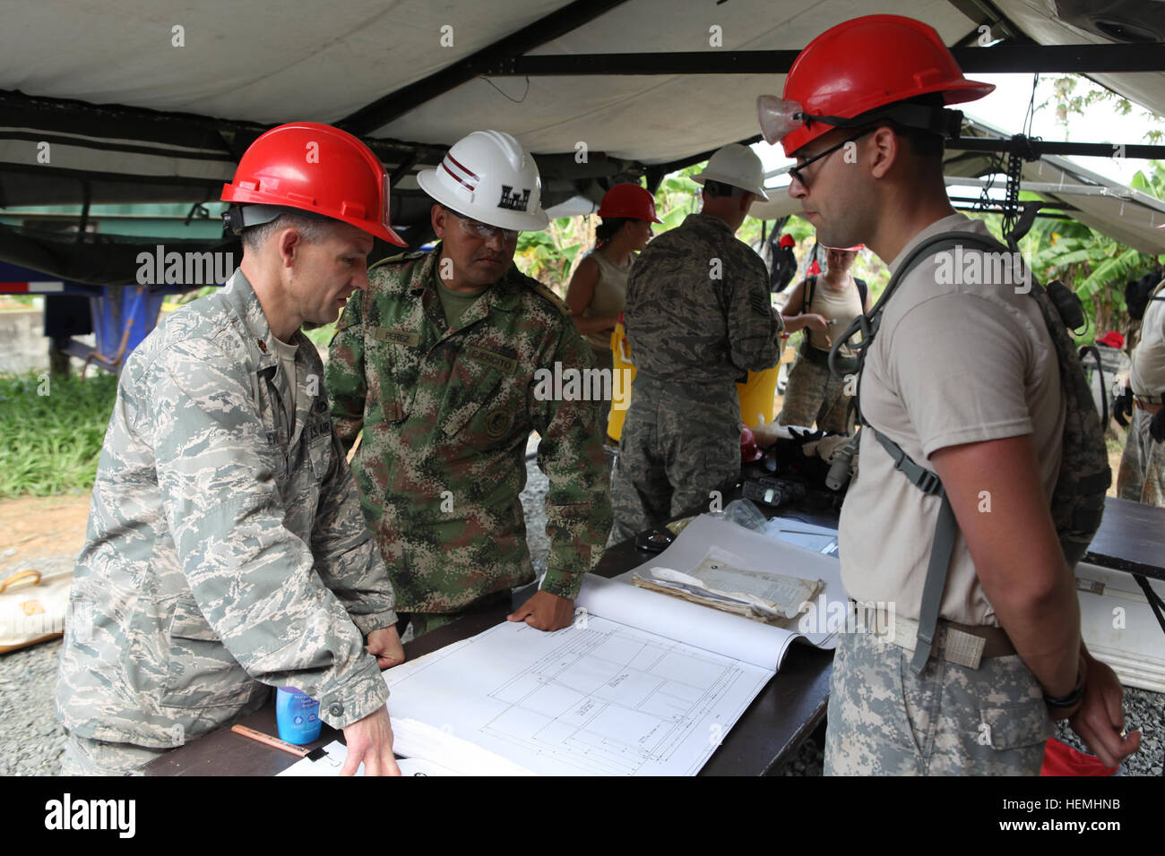 U.S. Air Force Major Craig Devore commander of the 200th Red Horse Squadron and a Columbian Combat Engineer look - Stock Image