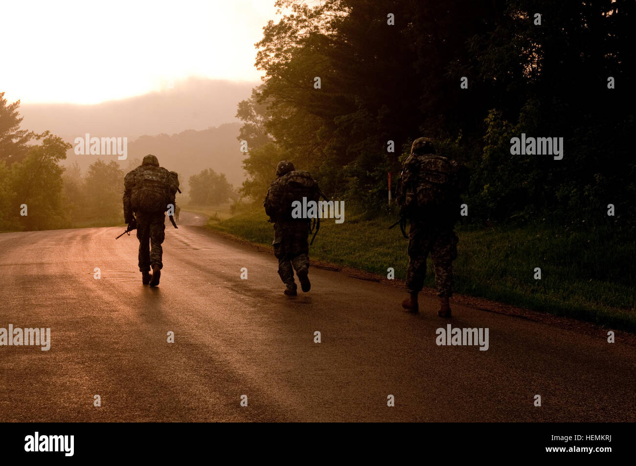 U.S. Soldiers walk along at a quick pace during the 10 kilometer road march event at the 2013 Army Reserve Best - Stock Image