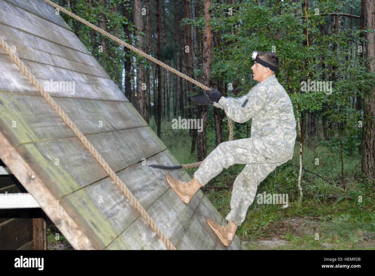 U.S. Army 2nd Lt. Michael Pikul, assigned to the 30th Medical Command,  gets over the 'Slanted Wall' on - Stock Image