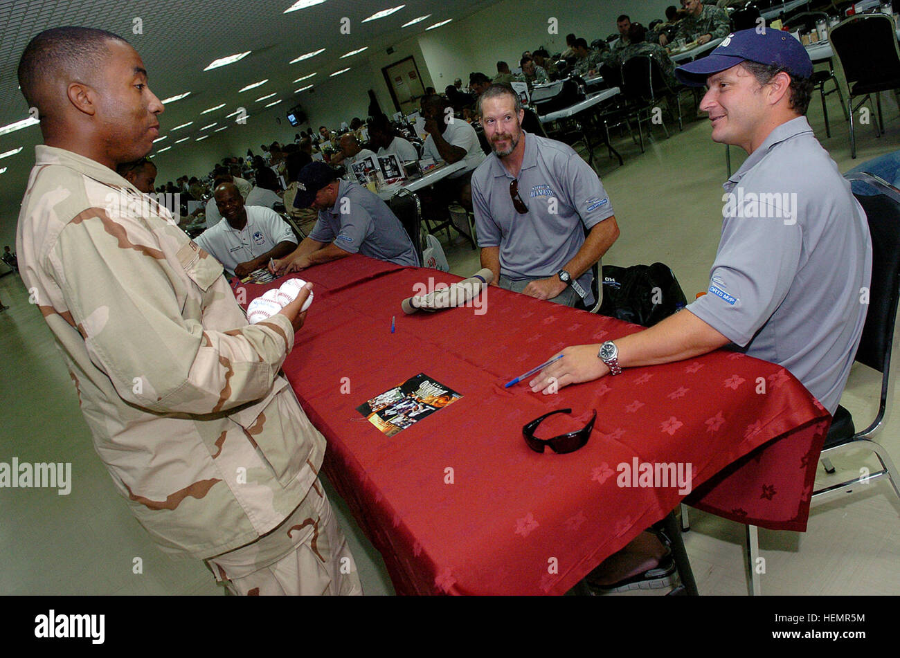 U.S. Navy Lt. Ivory Ervin, from Memphis, Tenn., questions Darren Bragg, a retired Major League Baseball player, - Stock Image
