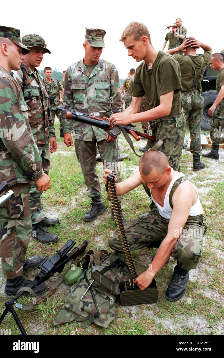 980605-A-3810A-013 Two Polish soldiers show a group of Marines their Polish made AK-47 7.62 mm rifle with a 14 mm - Stock Image
