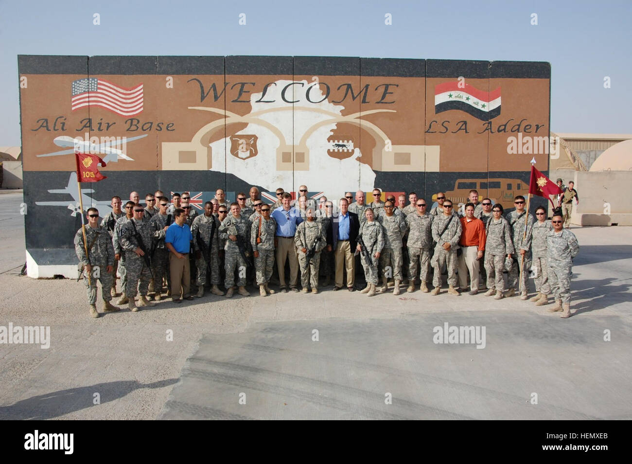 Soldiers serving at Contingency Operating Base Adder, Iraq, meet and pose with U.S. Reps. Patrick Murphy, D-Pa., Stock Photo