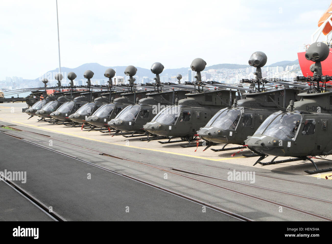 The OH-58D Kiowa Warrior helicopters are staged at Pier 8, Busan, Oct. 10. The 380 soldiers from the 4th Squadron, - Stock Image