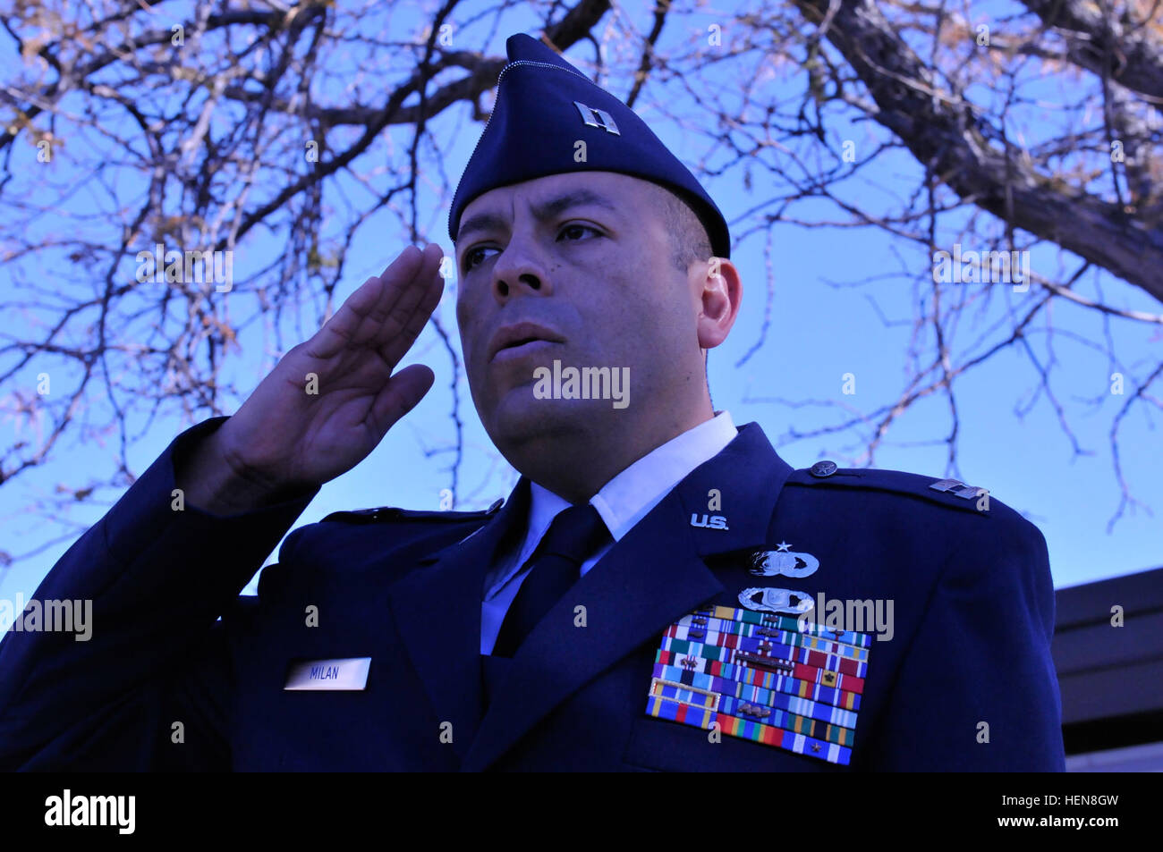 Air Force Capt. Jose Milian salutes the U.S. flag during a Veterans Day flag raising celebration at Burton Elementary Stock Photo