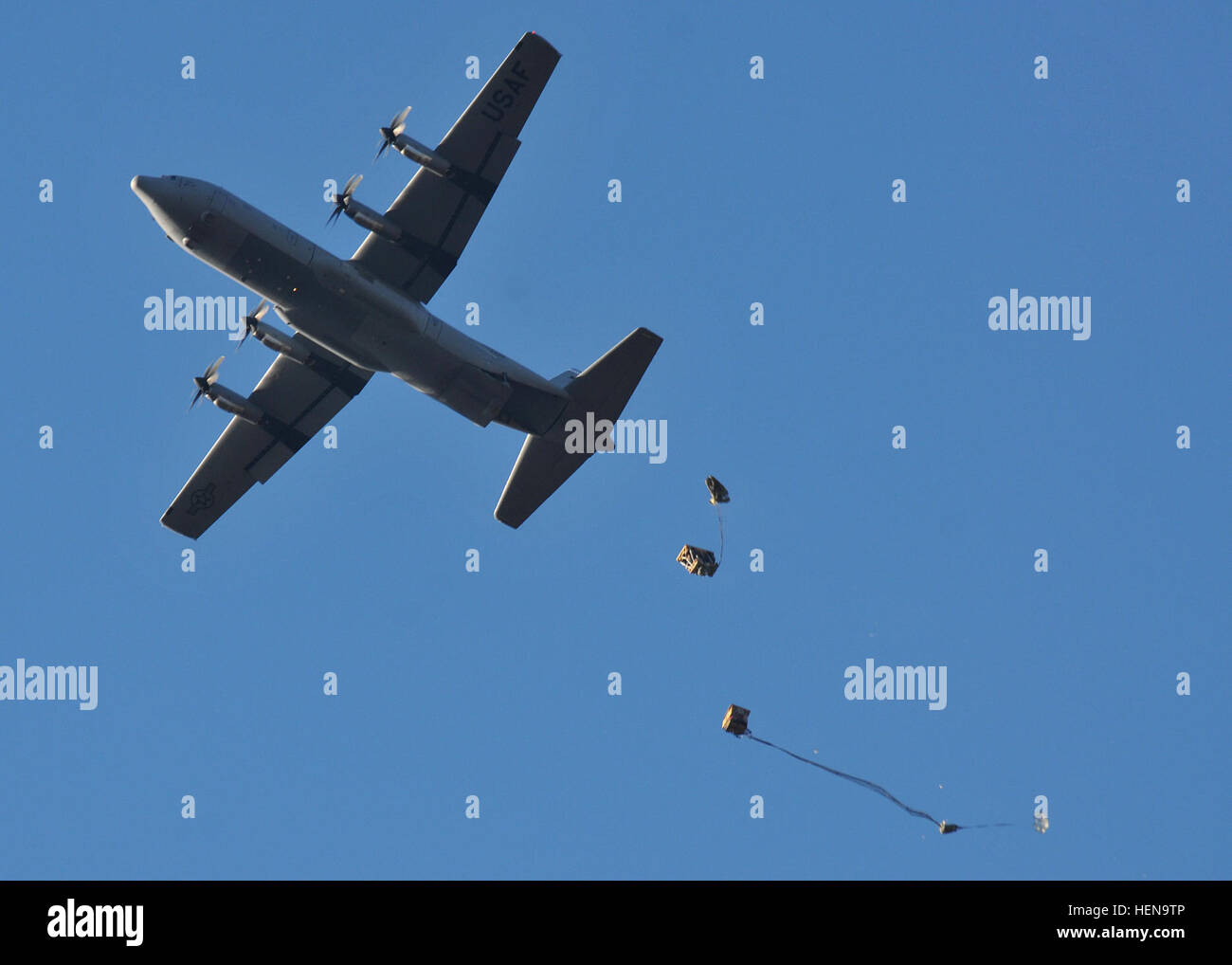 A C-130 aircraft drops a pallet of toys during an airborne operation over the Alzey Drop Zone Dec. 16.  U.S. and - Stock Image