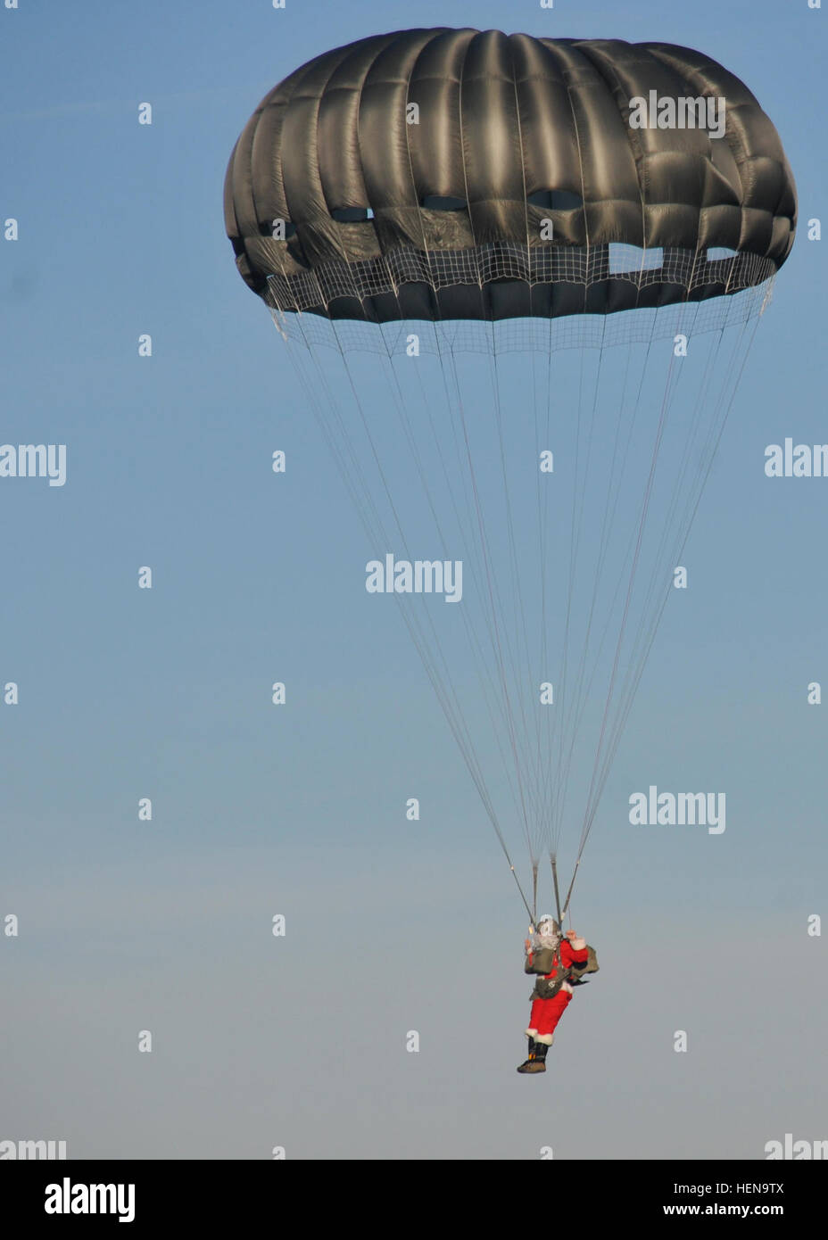 Santa Claus performs an airborne jump at the Alzey Drop Zone located near Kaiserslautern Dec. 16. Operation Toy - Stock Image