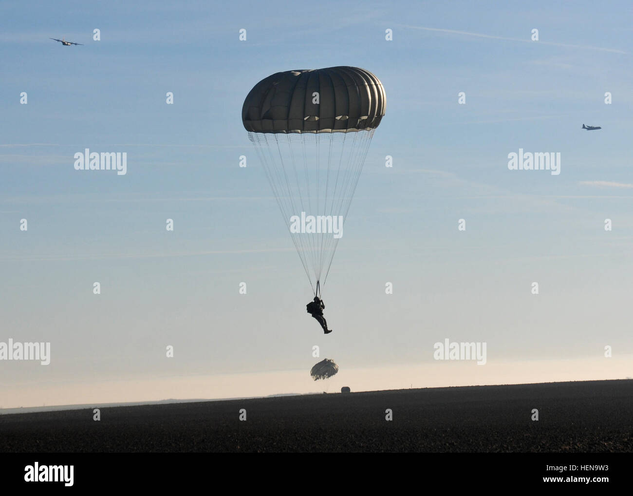 A paratrooper from the 5th Quartermaster Detachment (Airborne), 21st Theater Sustainment Command, jumps onto the - Stock Image