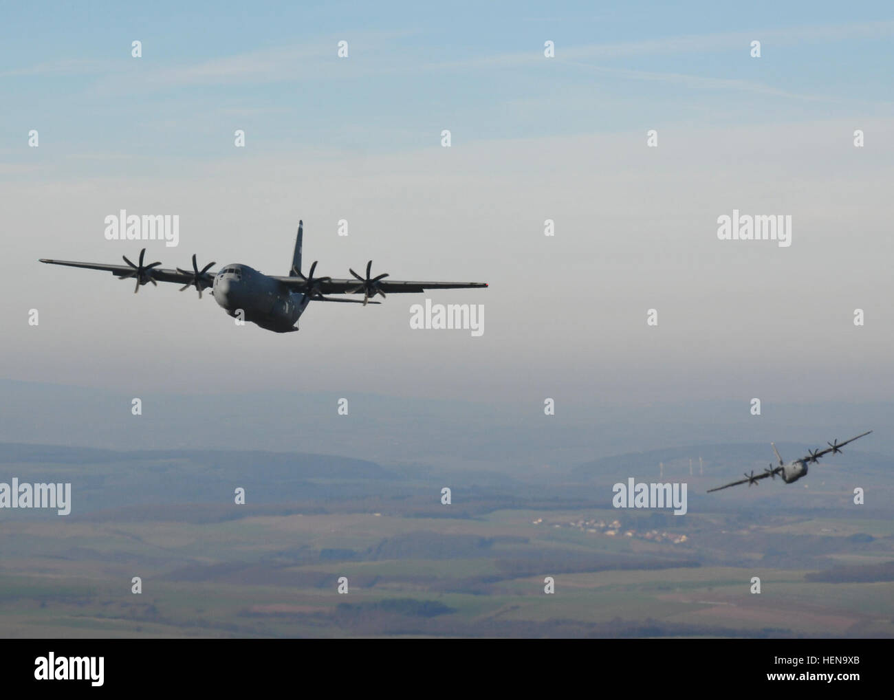 Two C-130 aircraft line-up in preparation to drop U.S. and partner nation paratroopers during an airborne operation - Stock Image