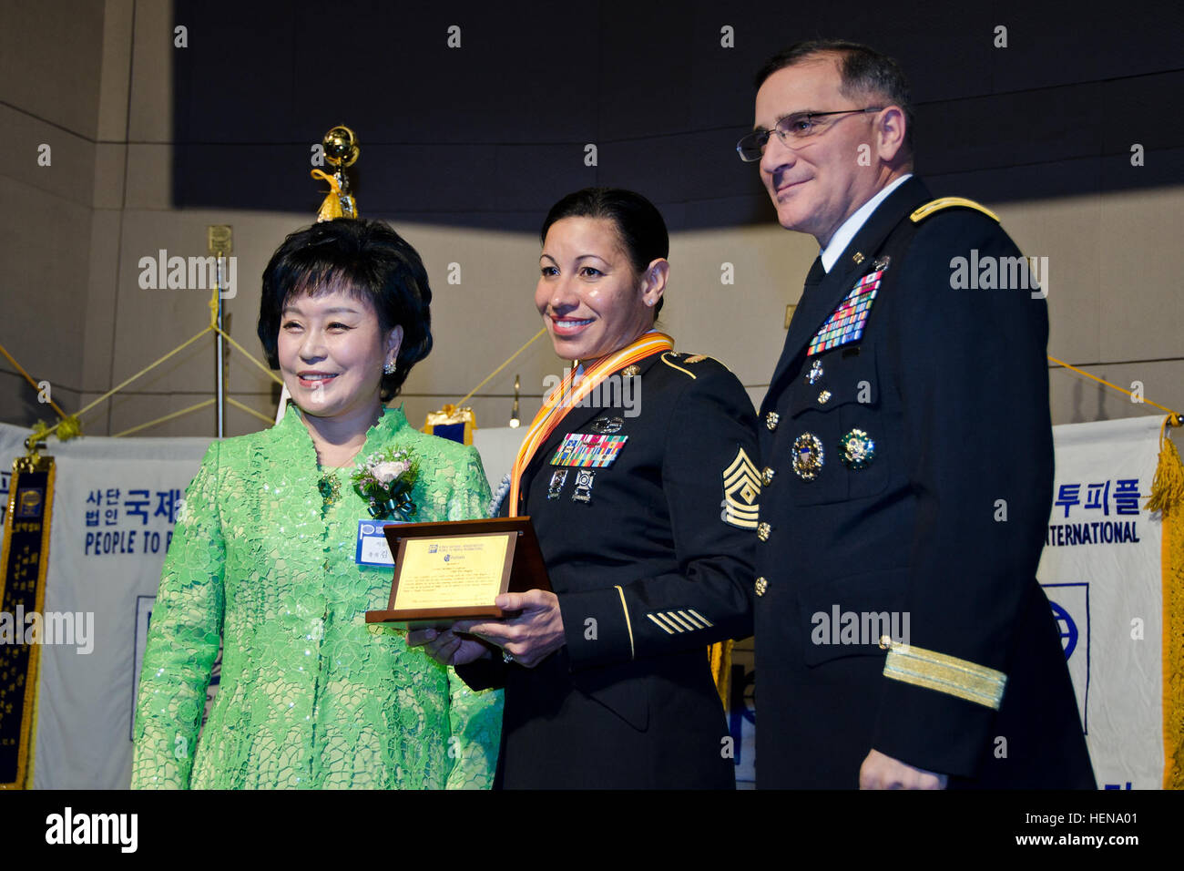 U.S. Army First Sgt. Donna Swan, assigned to Headquarters and Headquarters Company, is recognized for her community - Stock Image