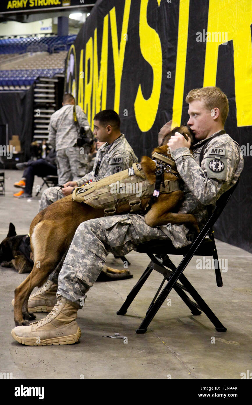 A military police officer and his canine partner take a moment to share mutual affection during the 2014 U.S. Army - Stock Image