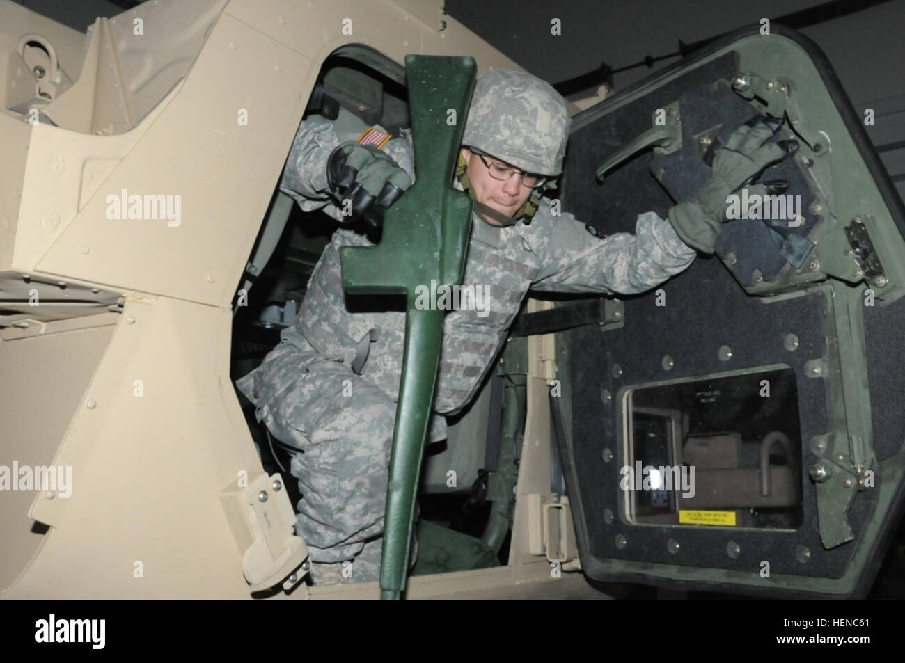 Spc. Robert R. Ortiz Jr., a supply specialist with the Army Reserve Medical Commands in Pinellas Park, Fla., exits - Stock Image