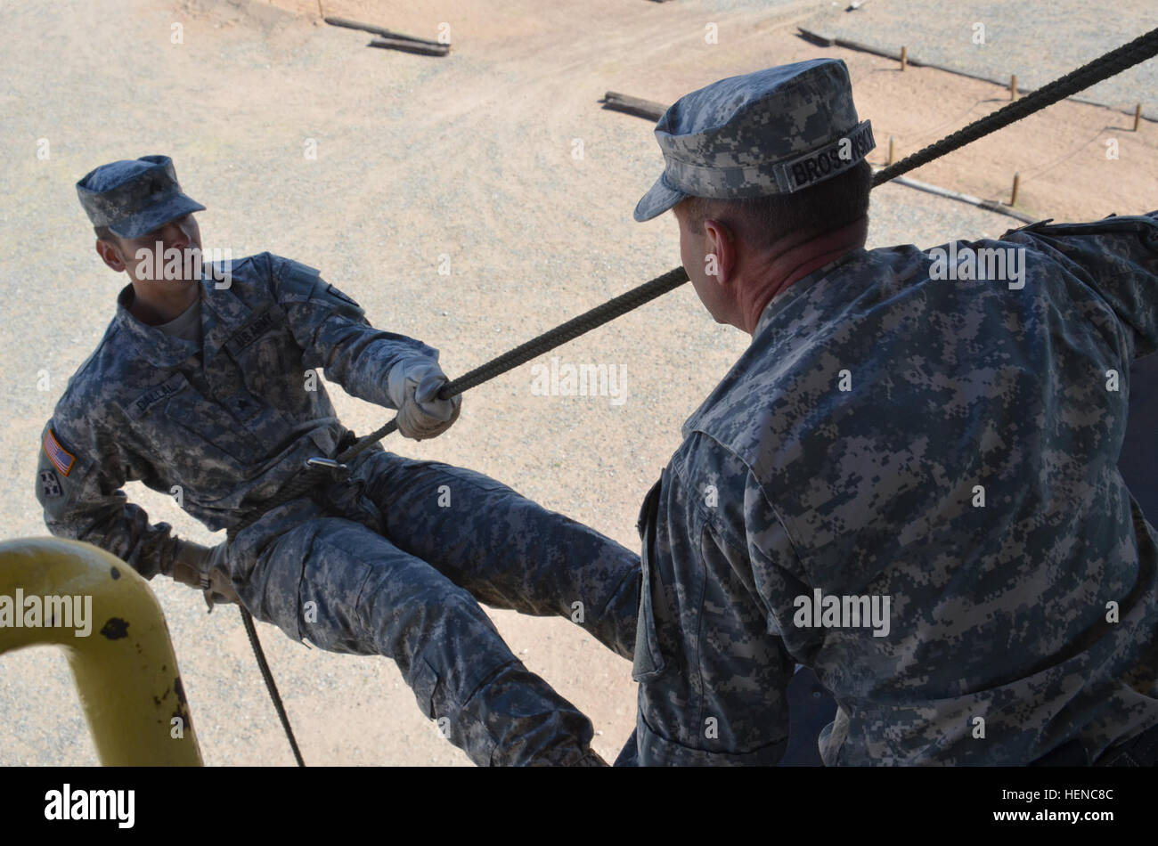 A Soldier rappels off a tower during training on Fort Bliss, Texas, Feb. 27. Soldiers with the 32nd Army Air and - Stock Image