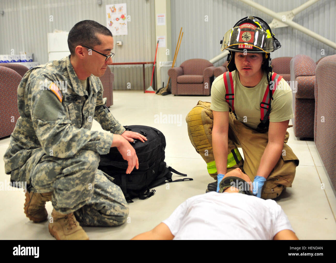 Spc. Thomas P. Shields, left, a medic assigned to the 21st Theater Sustainment Command's 557th Medical Company, - Stock Image