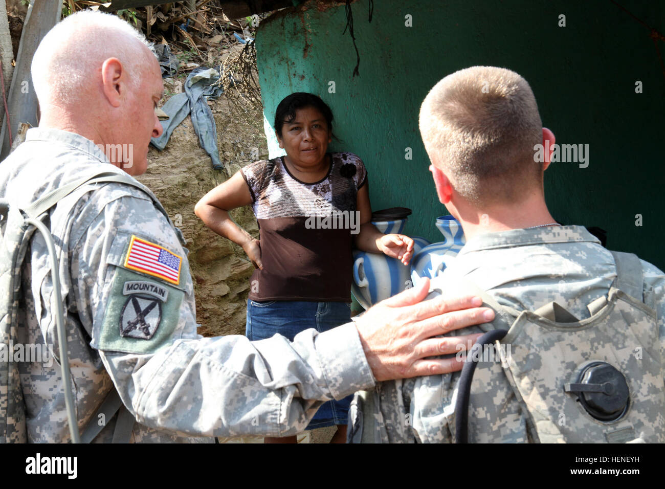 Master Sgt. John Barneson and Spc. Paul Gentle, assigned to the 318th PsyOp Company, speaks with a Guatemalan woman, Stock Photo