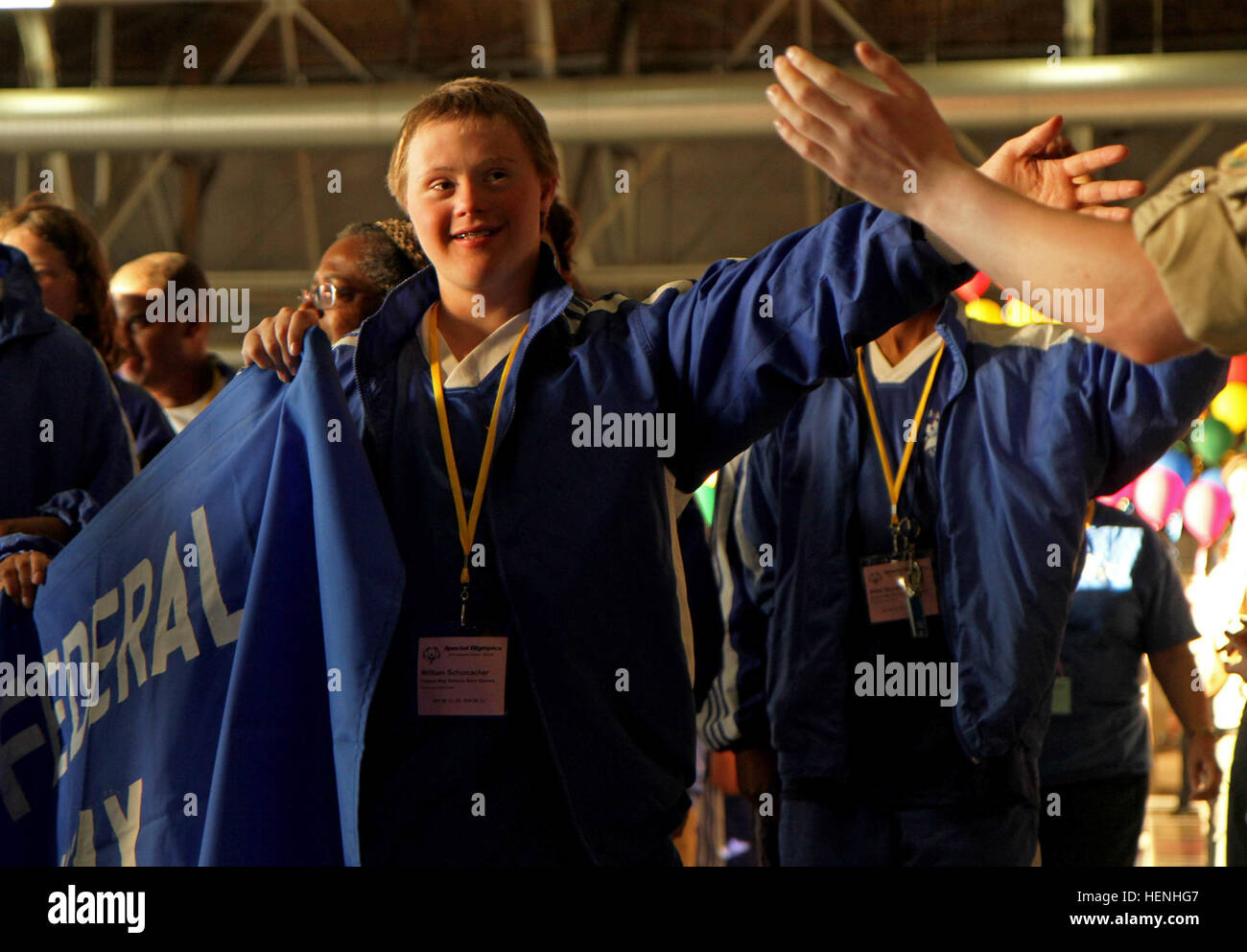 JOINT BASE LEWIS-MCCHORD, Wash. -- A young Federal Way athlete competing in the Washington Special Olympics  extends Stock Photo