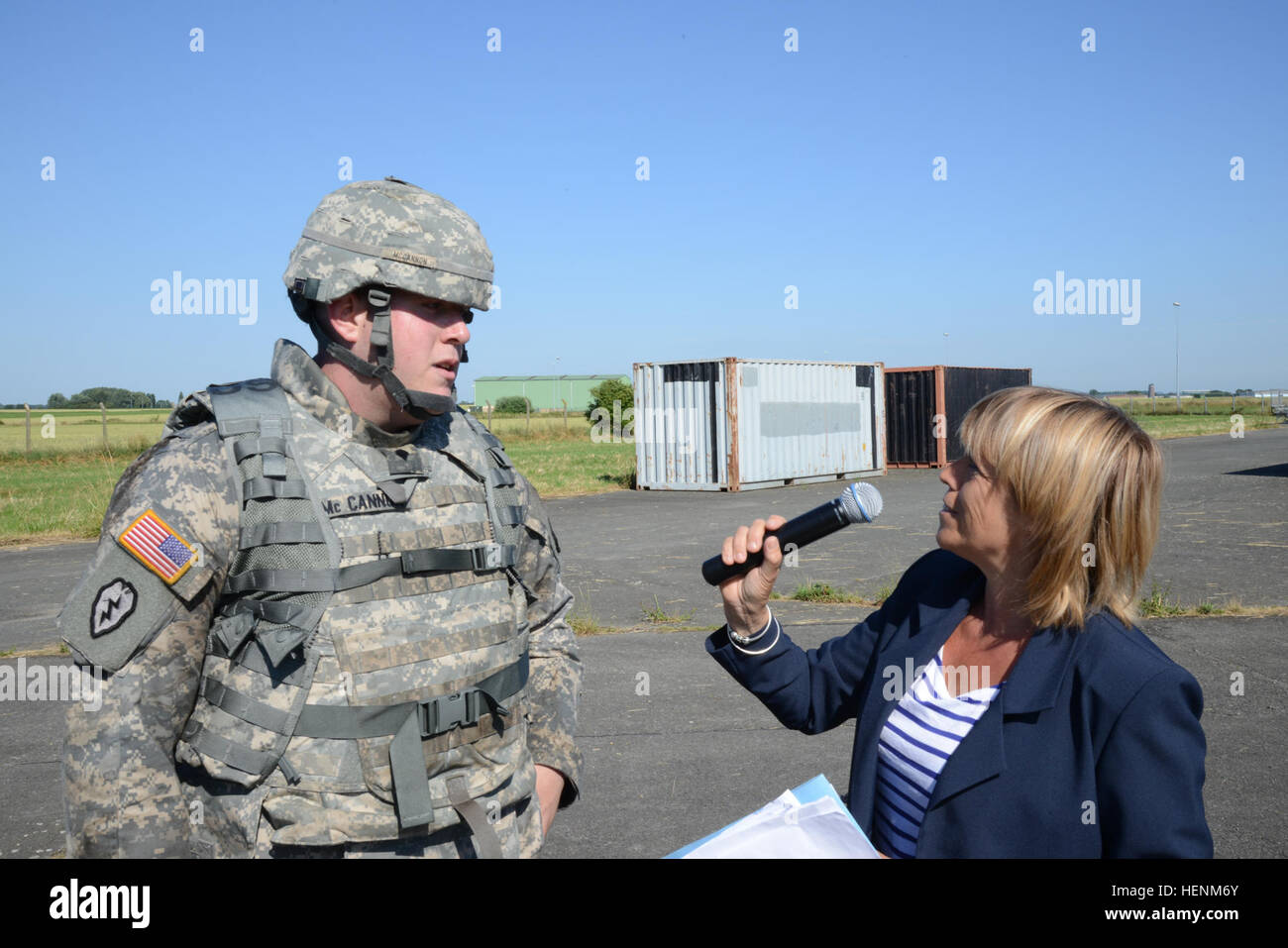 U.S. Army Spc. Mc Cannon, with U.S. Army Garrison Benelux, replies with parsimony on intrusive questions of a simulator - Stock Image