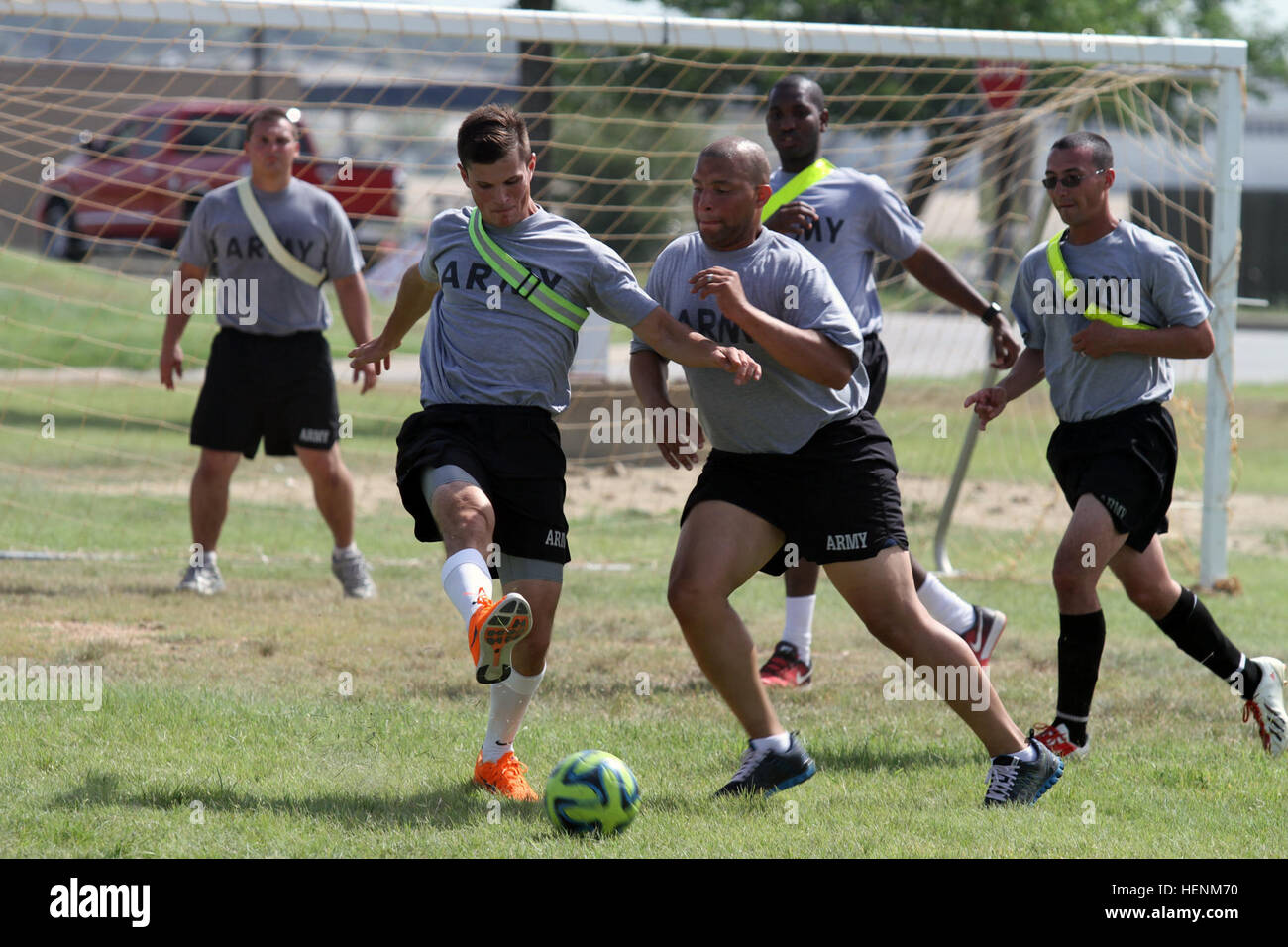 Troops fight to maintain offensive possession of the ball during a soccer game as part of the 'Warrior Challenge' - Stock Image