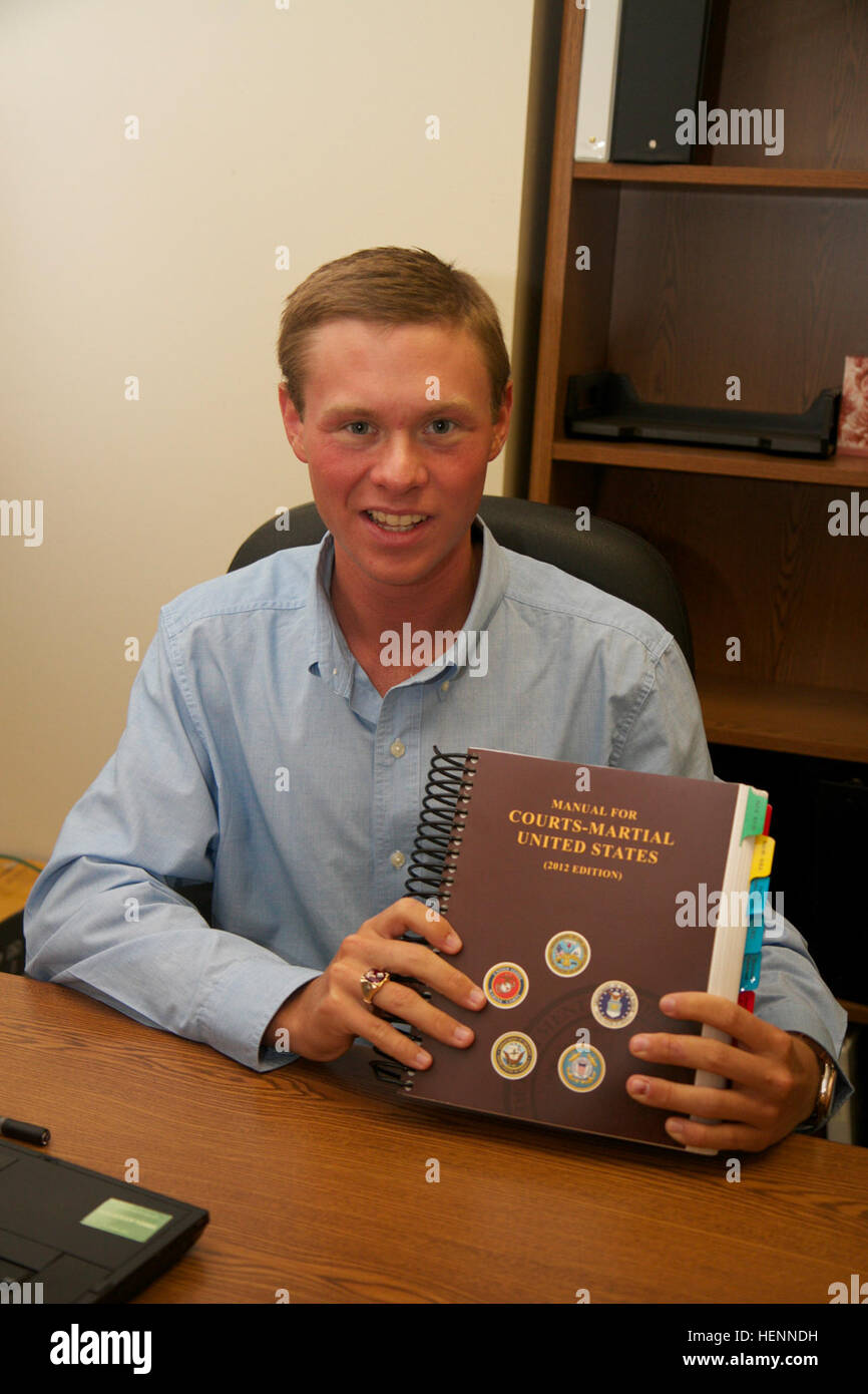 Parker Gochenour displays the United States Manual for Courts-Martial while  interning with the 1st Cavalry Division's Office of Judge Advocate at Fort  Hood, ...