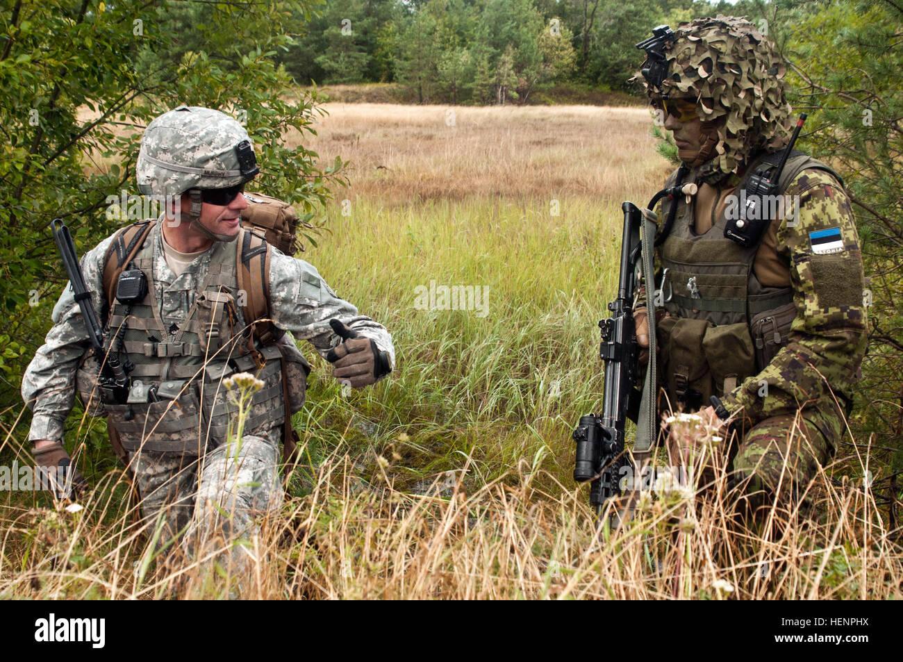 Staff Sgt. Ross A. Murphy (left), a Raleigh, N.C., native serving as a platoon sergeant in Company B, 2nd Battalion, Stock Photo