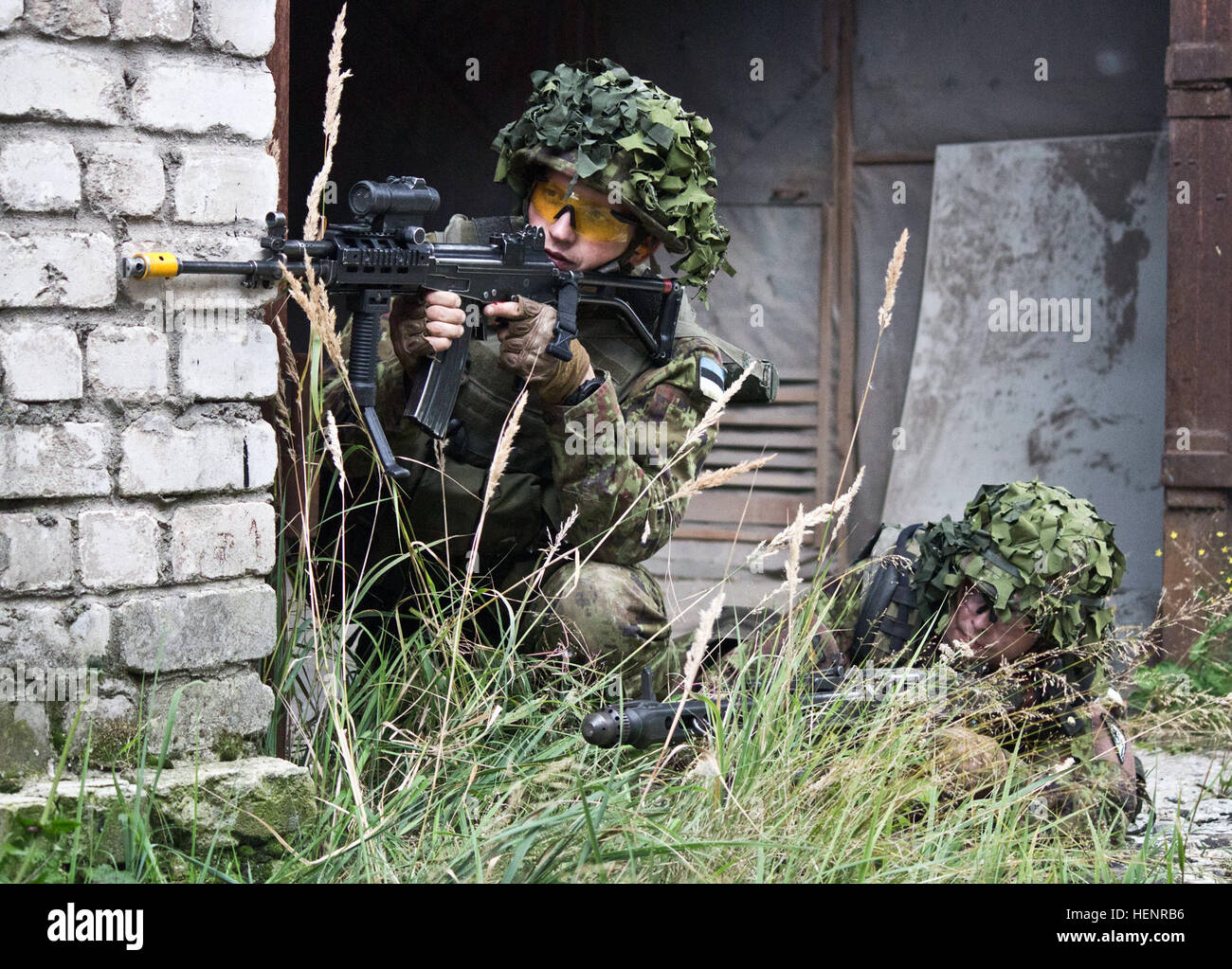 Estonian Defense Forces soldiers from Company C, Single Scouts Infantry Battalion provide covering fire during a Stock Photo