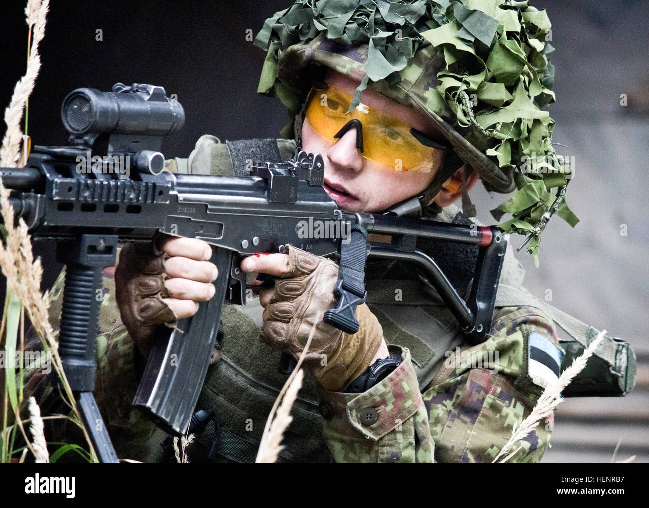An Estonian Defense Forces soldier from Company C, Single Scouts Infantry Battalion aims his Galil rifle at Estonian Stock Photo