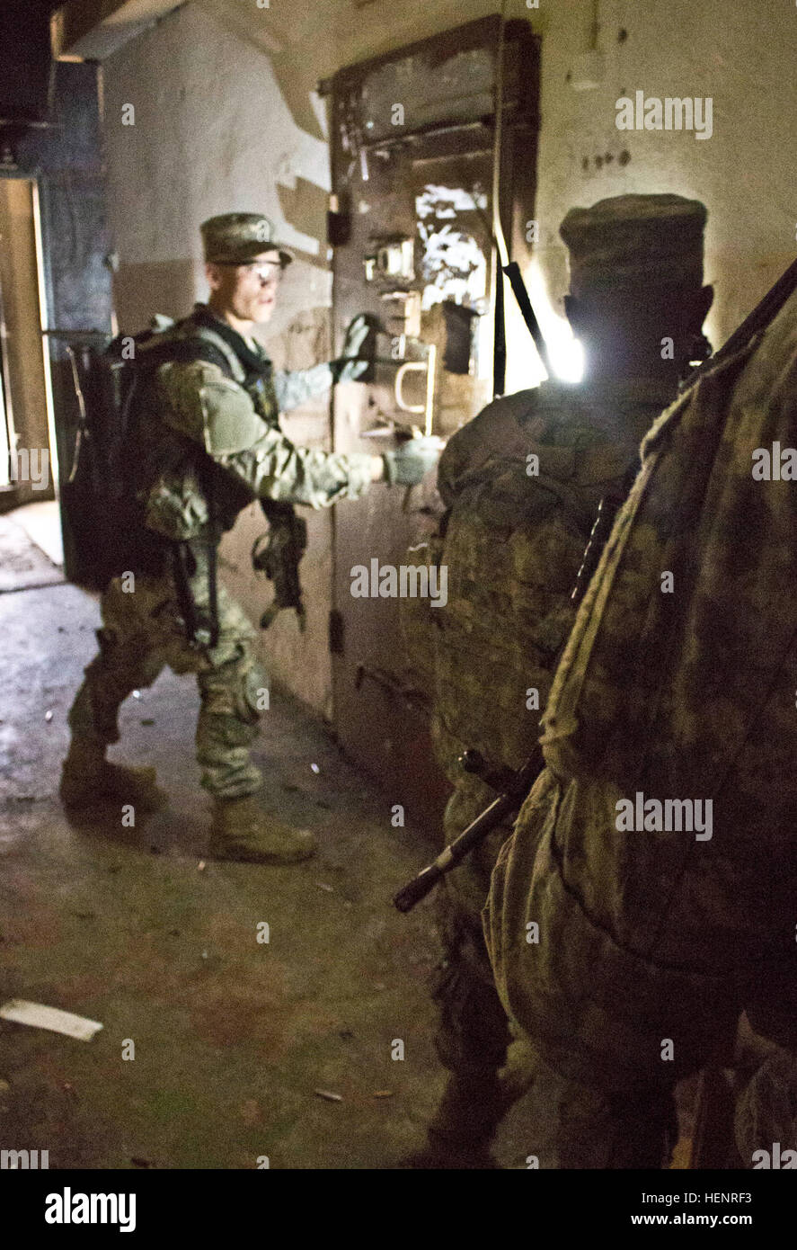 Army Pvt. Dustin M. Stechschulte, a Lima, Ohio, native serving as an infantryman in Company B, 2nd Battalion, 503rd Infantry Regiment, 173rd Airborne Brigade leads his team in breaching a cell inside an abandoned Soviet era prison during a rehearsal for a night raid mission held Sept. 5 at Rummu, Estonia. The raid was part of Steadfast Javelin II, a NATO exercise involving more than 2,000 troops from nine nations conducting various training missions across Estonia, Germany, Latvia, Lithuania and Poland. The exercise focuses on increasing interoperability and synchronizing complex operations be Stock Photo