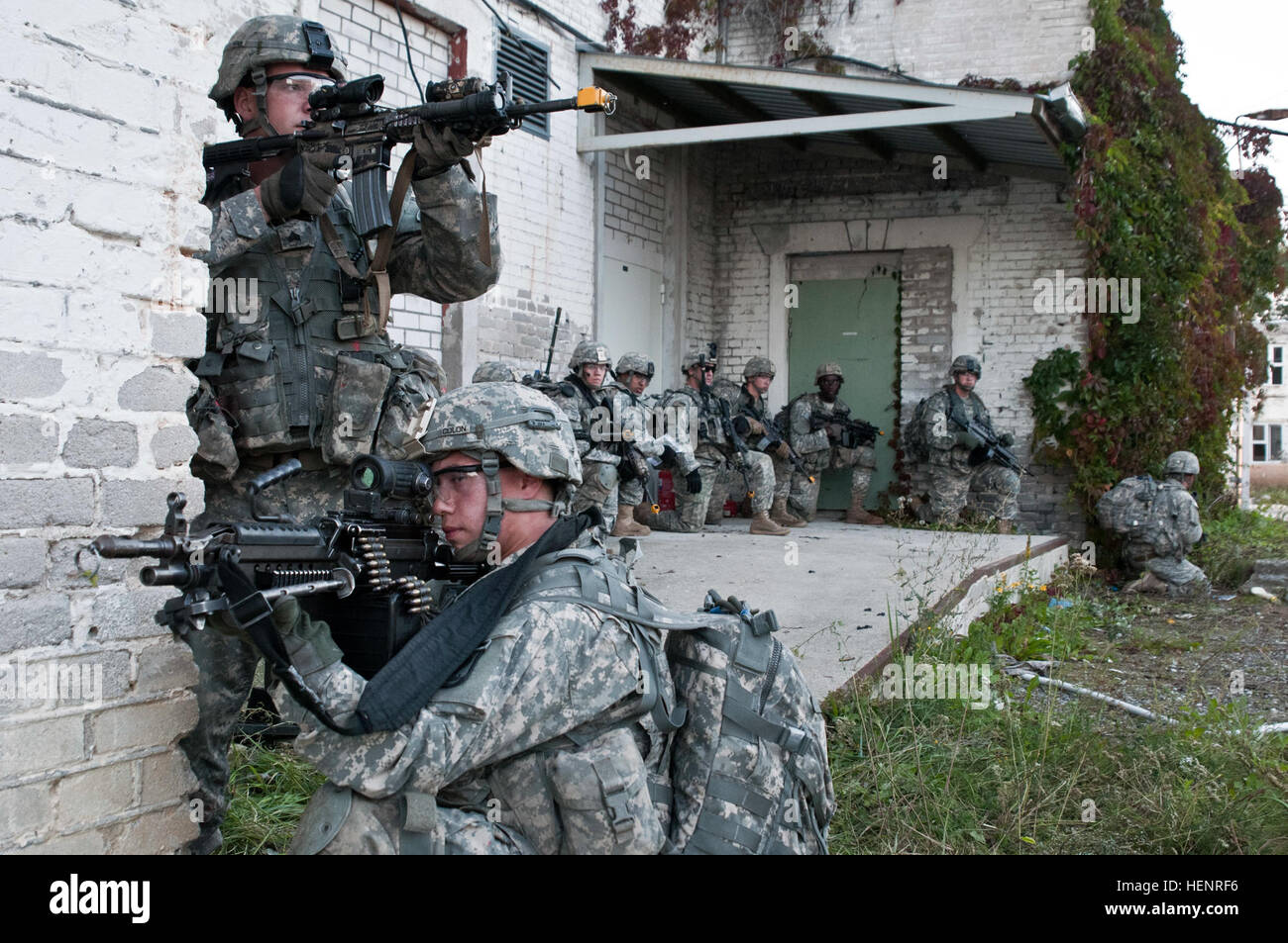 Paratroopers from Company B, 2nd Battalion, 503rd Infantry Regiment,173rd Airborne Brigade pull security at an abandoned Stock Photo