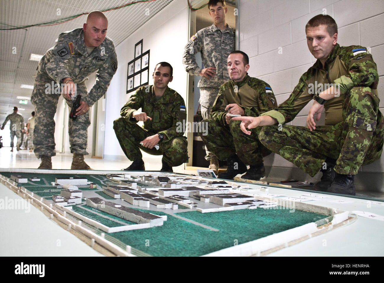 Using a model of an abandoned Soviet era prison as a visual aid, Army Sgt. 1st Class Derek J. Ertmer (left), a Stockton, Stock Photo