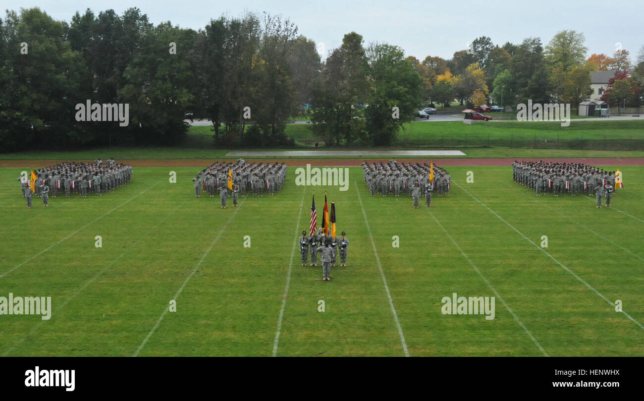 Troops assigned to 2nd Cavalry Regiment salute while the national anthem plays during the change of responsibility - Stock Image