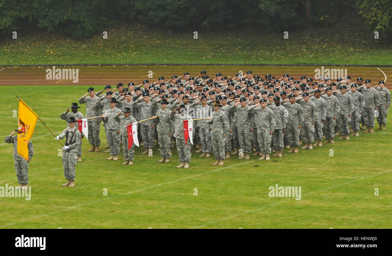 Troops assigned to 1st Squadron, 2nd Cavalry Regiment salute while the national anthem plays during the change of - Stock Image