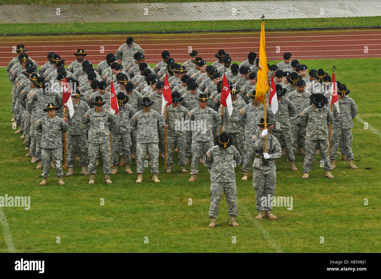 Troops assigned to 4th Squadron, 2nd Cavalry Regiment stand at parade rest while the chaplain conducts a prayer - Stock Image