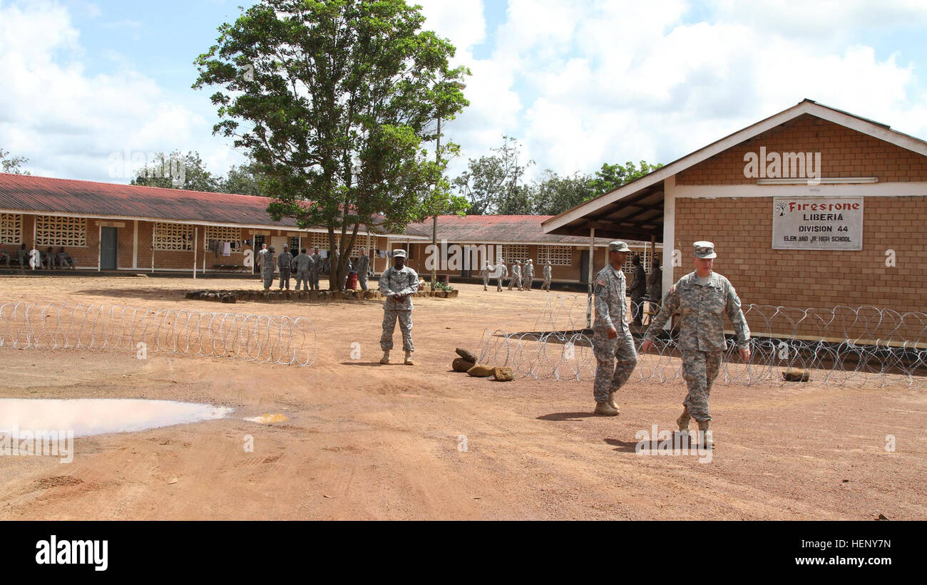 Soldiers from Task Force Lifeliner make a schoolhouse their home Nov. 6, 2014, in Monrovia, Liberia. School is currently - Stock Image