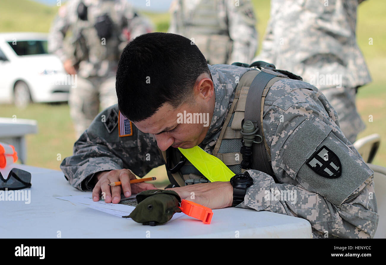 Army Sgt. Gregory J. Maldonado plots points on a map during the land navigation course for the Local Best Warrior - Stock Image