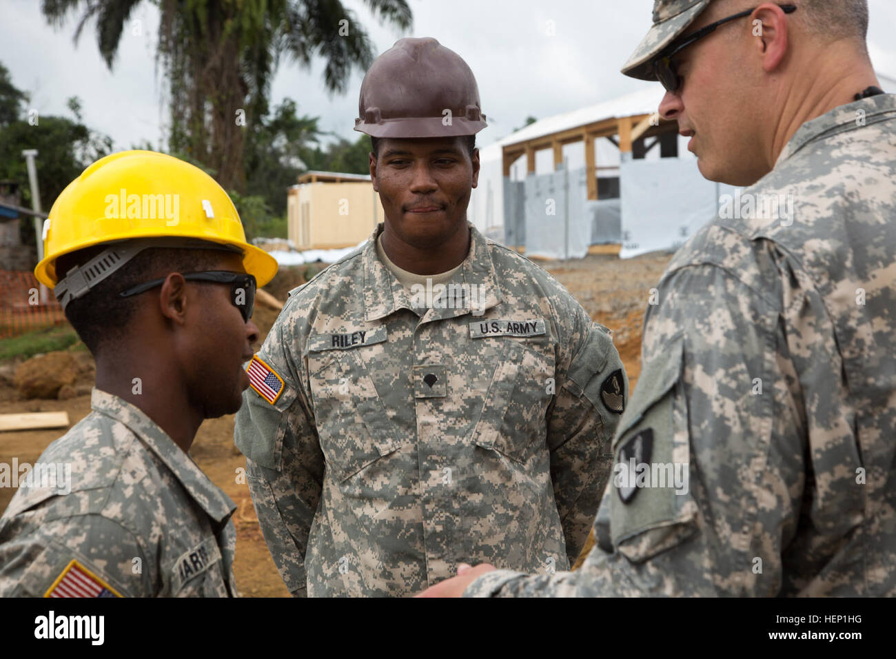 From Left Pfc Shane Harris And Spc Ike Riley Soldiers With The 36th Engineer Brigade Meet Col Heath Roscoe Commander Of