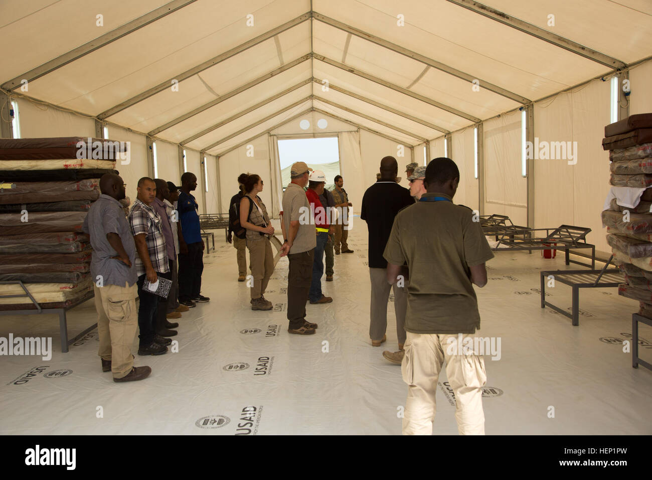 Construction contractors and international aid workers tour a newly completed Ebola treatment unit built in support Stock Photo