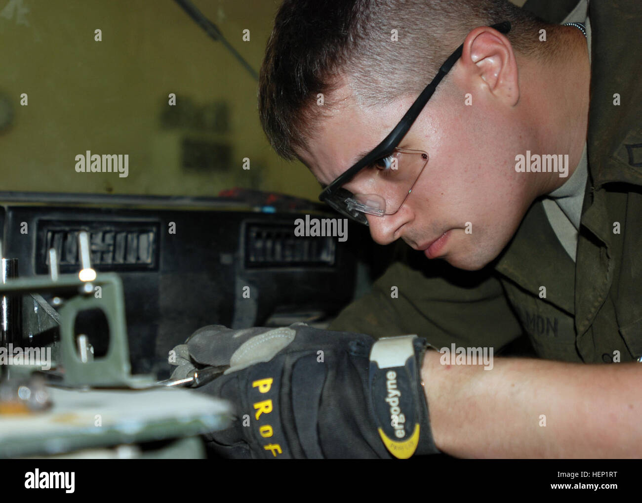 Pfc. Jacob Gilmon, a Leander, Texas, native, who serves as a wheeled-vehicle mechanic with Headquarters Support - Stock Image