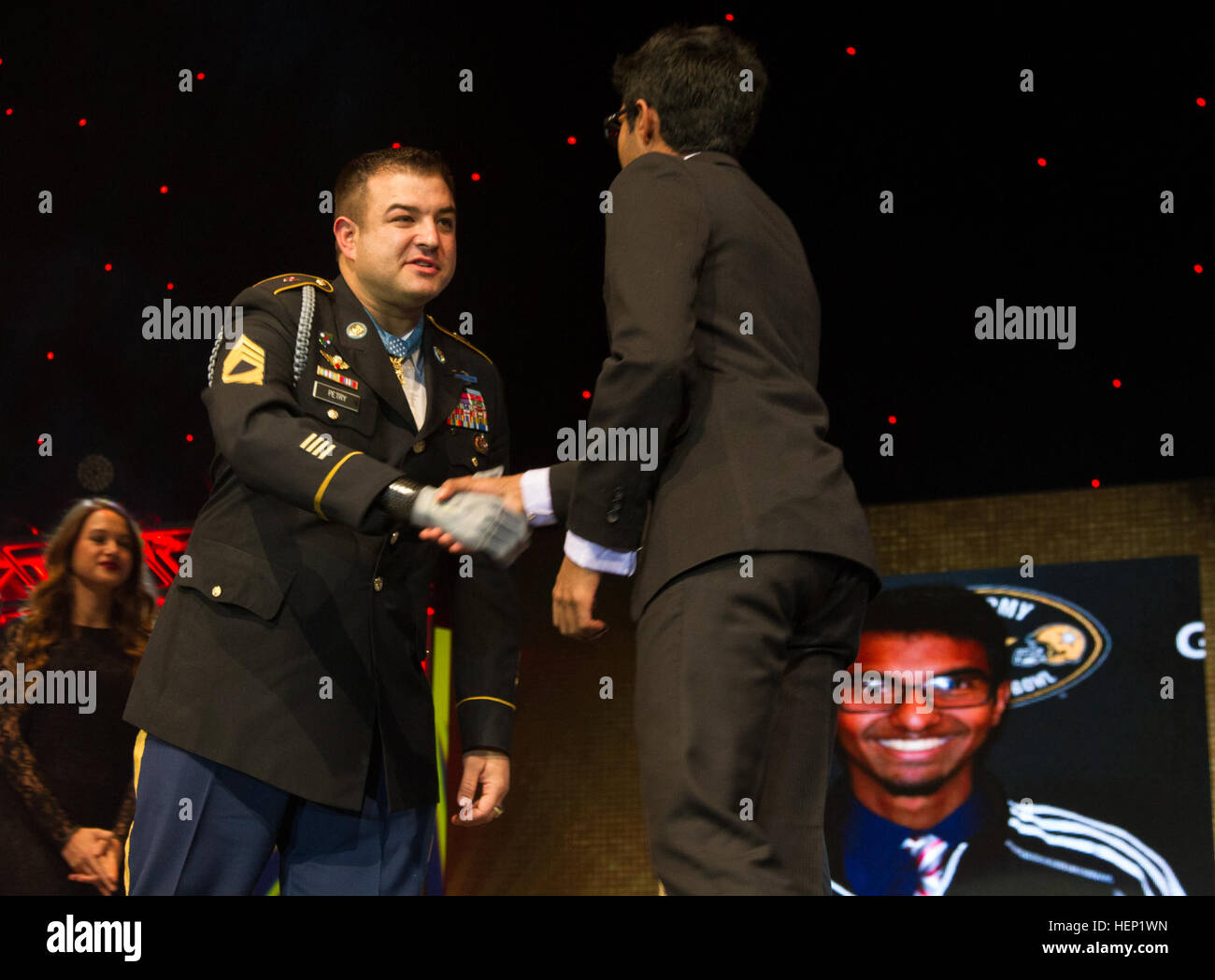 Retired Master Sgt. and Medal of Honor recipient Leroy A. Petry shakes hands with Prashant Chakradhar, Murray High - Stock Image