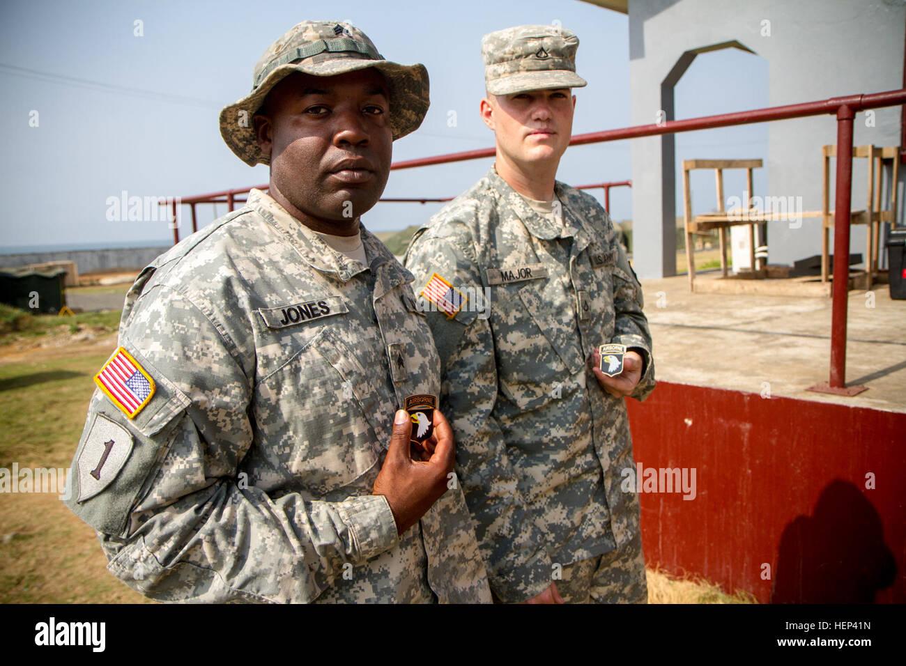 Sgt. Elijah Jones, left, a power generator equipment repairman, with the 82nd Civil Affairs Battalion, and Pfc. - Stock Image