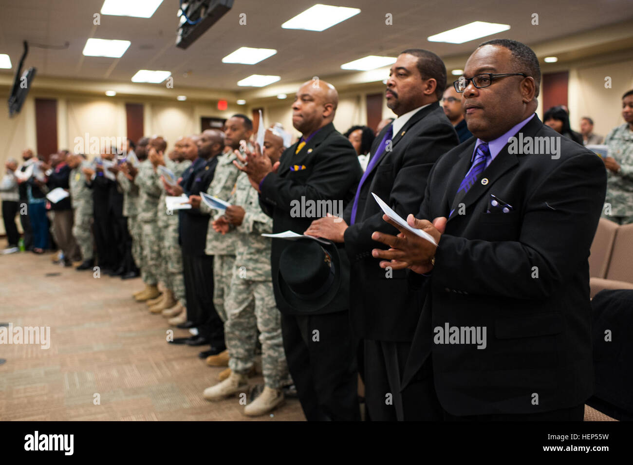 Members of the Omega Psi Phi fraternity and others applaud Andrew T. Brown during a Remembrance Service held in - Stock Image