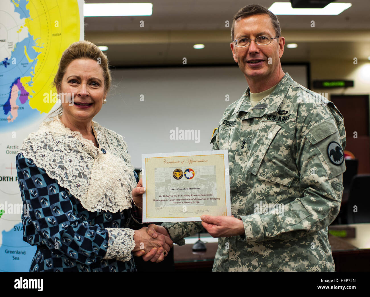 Kate Campbell Stevenson, left, is presented a certificate of appreciation from Maj. Gen. David Conboy, U.S. Army Stock Photo