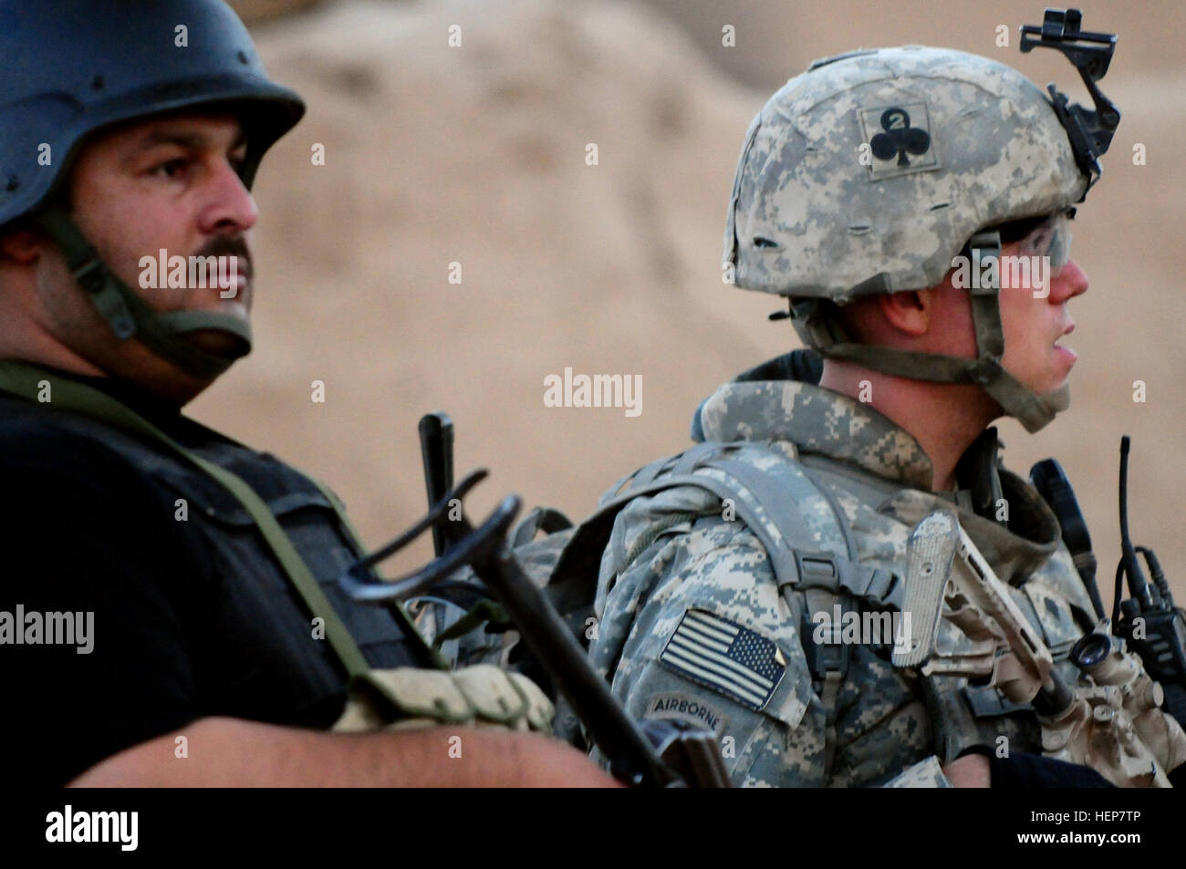 An Iraqi SWAT team member searches a village near Balad, alongside a Soldier from the 1st Special Troops Battalion, - Stock Image