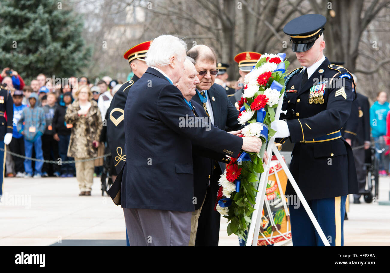 From left, Medal of Honor recipients Bruce Crandall, Kenneth Stumpf and Harold Fritz lay a wreath at the Tomb of the Unknown Soldier in Arlington National Cemetery, March 25, 2015. Medal of Honor recipients laid a wreath and then later held a ceremony to present Citizen Honors medals at the Women In Military Service For America Memorial in Arlington, Va., as part of Medal of Honor Day. (Joint Base Myer-Henderson Hall PAO photo by Rachel Larue) Twenty-eight Medal of Honor recipients gather at ANC for National MOH Day 150325-A-DZ999-605 Stock Photo