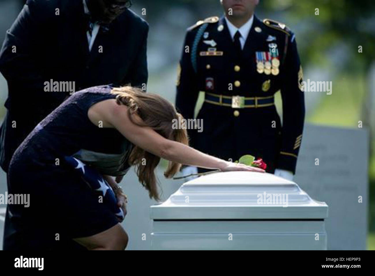 Dr. Susan Myers, widow of Maj. Gen. Harold J. Greene, places a red rose on her husband's casket following a - Stock Image