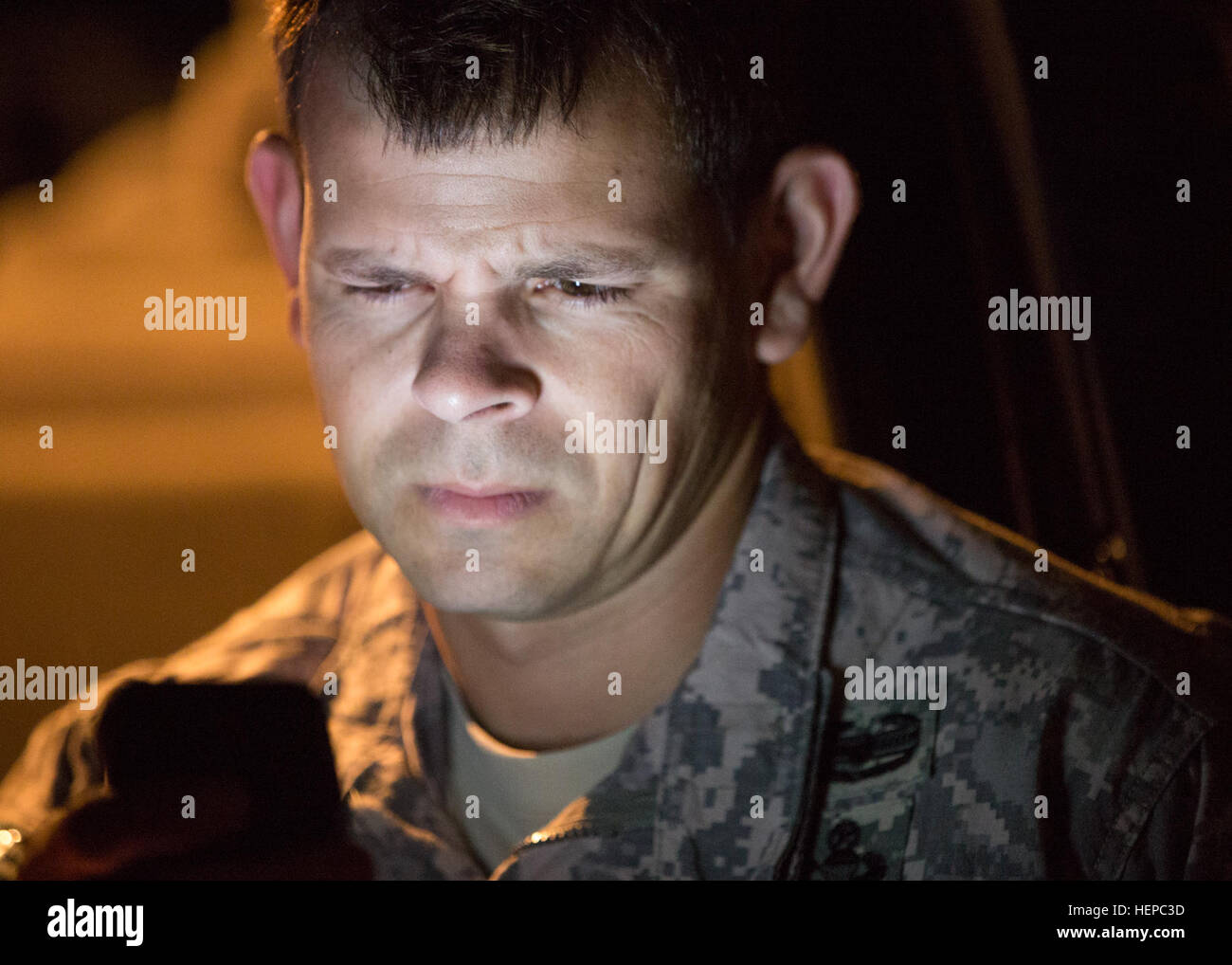 U.S. Army Sgt. 1st Class Luis Irizarry checks the weather and wind conditions during night airborne operations training Stock Photo
