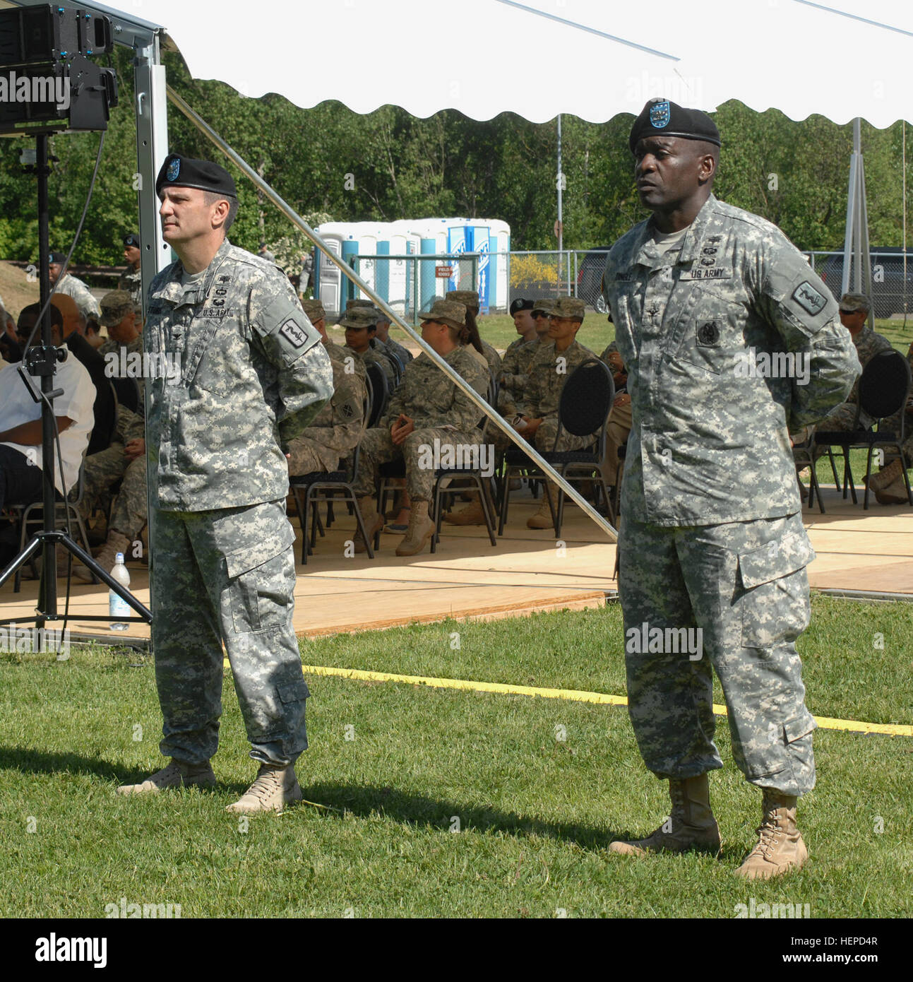 The incoming and outgoing commanders  stand and wait for their time to give words to the brigade during the 30th - Stock Image