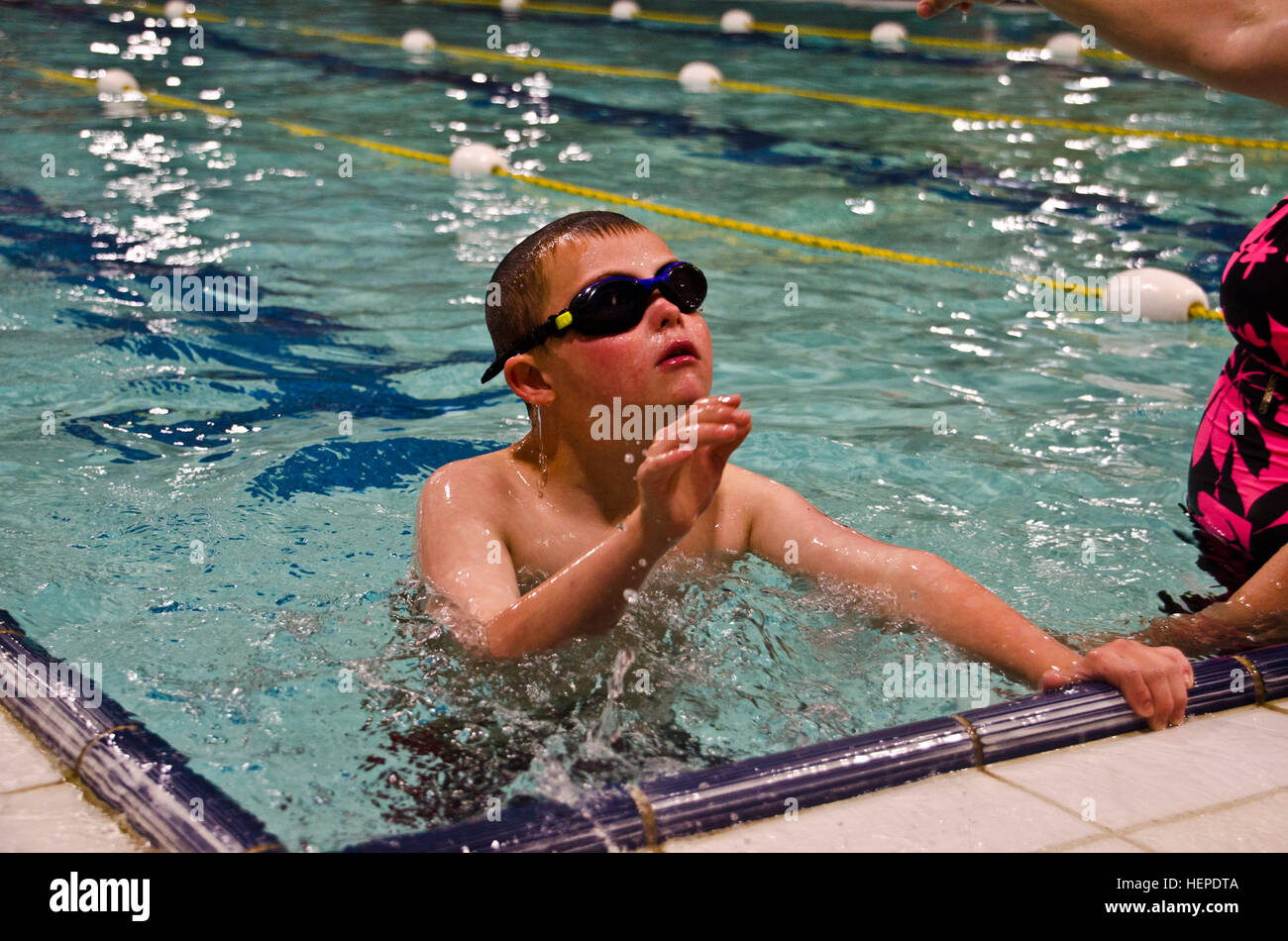 """Ezekiel """"Zeke"""" McCarley, 10-year-old Special Olympics aquatic competitor, gets ready to compete for the 2015 Special - Stock Image"""