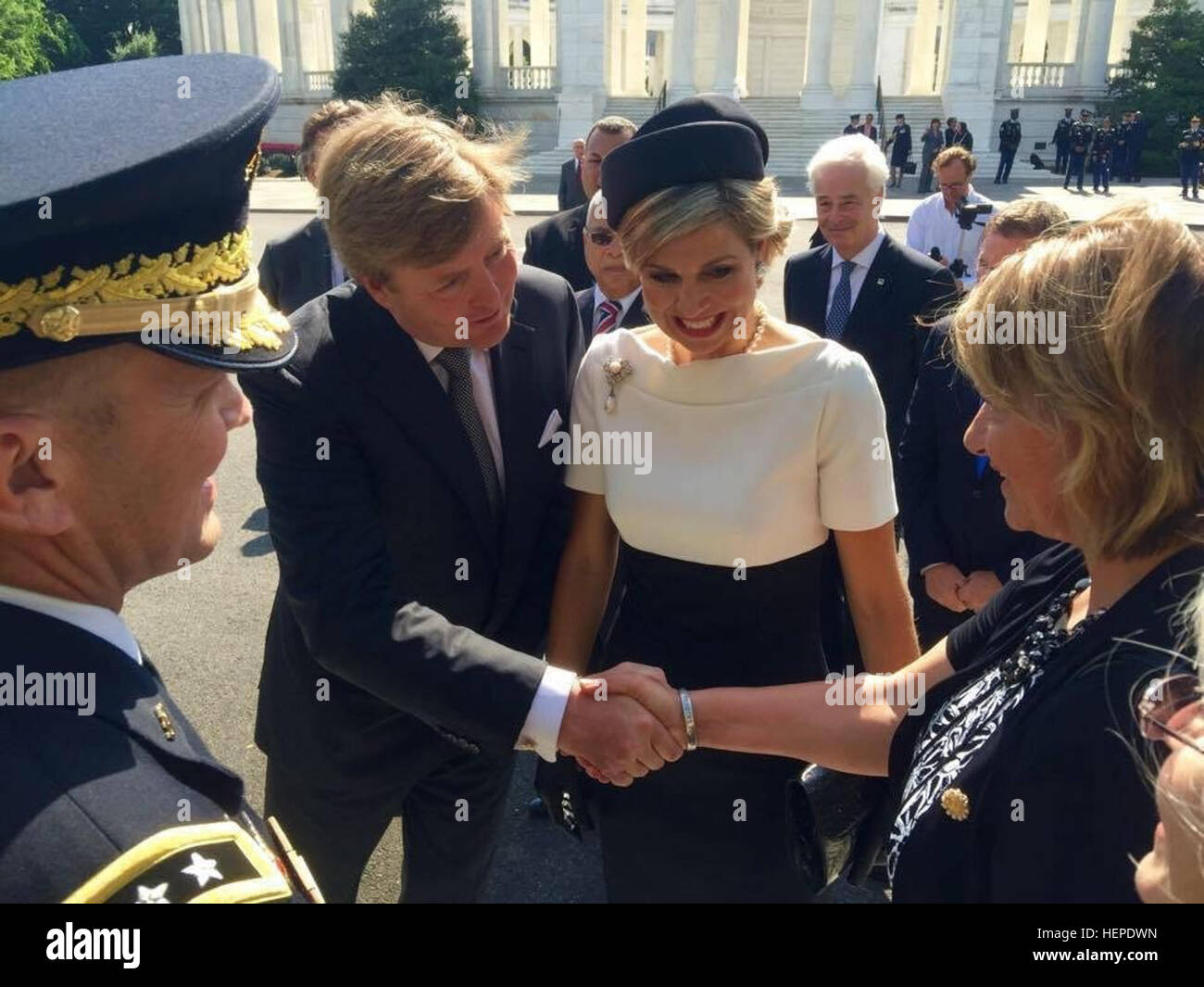 Monique Ryan, retired chief warrant officer 3, far right, greets King Willem-Alexander, with Queen Maxima during - Stock Image